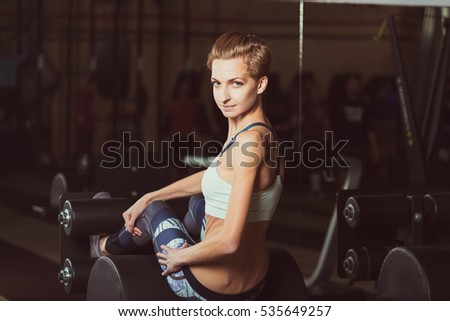 Gym. She shakes the press