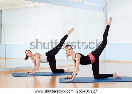 cute hispanic women practicing cobra pose stock photo