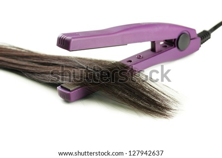 Hair straighteners and hair, isolated on white