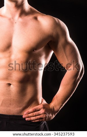 half body of muscular bodybuilder man, upper body , isolated with black background