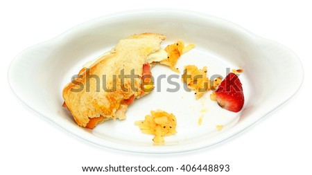 Half Eaten Egg Sandwich, Hashbrown, Strawberry in white plate isolated over white. Top view.