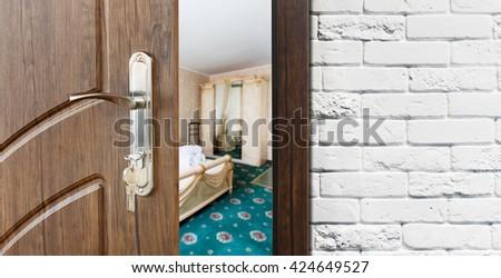 half opened door to a bedroom door handle door lock lounge door half