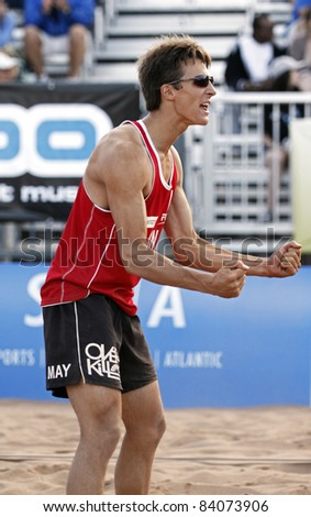 HALIFAX, CANADA - SEPTEMBER 2: Garrett May of Canada celebrates a point at the FIVB Beach Volleyball Swatch Junior World Championships on Sept. 2, 2011 in Halifax, Canada.