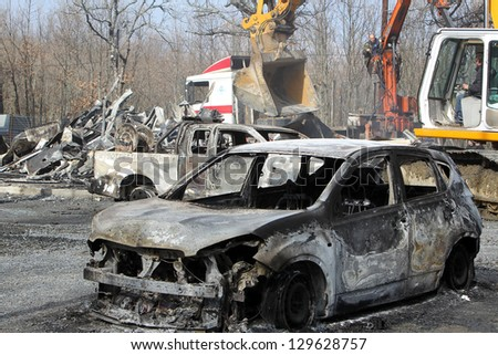 HALKIDIKI,GREECE-FEB 17:Group of 40 men threw molotov cocktails & set fire to equipment at the Hellenic Gold site, damaging containers, cars & trucks in the northern region of Halkidiki, Feb. 17, 2013