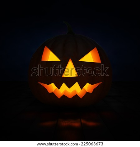 Halloween concept design background - scary Jack-o'-lantern carved pumpkin with candle light inside