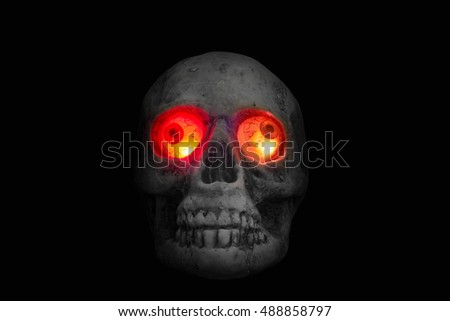 Halloween concept with a pumpkin,skeleton,candles and toy spider on a cobweb wood background