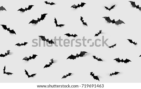 halloween decorations concept seamless pattern with black paper bats on grey background