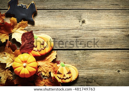Halloween homemade gingerbread cookies over wooden background