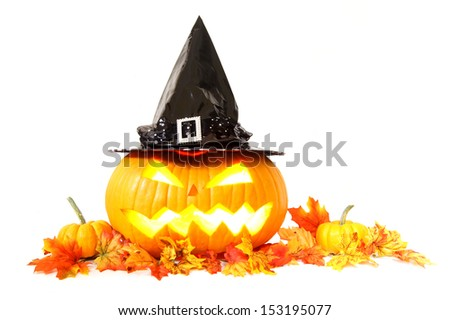 Halloween Jack o Lantern with witch hat and autumn leaves