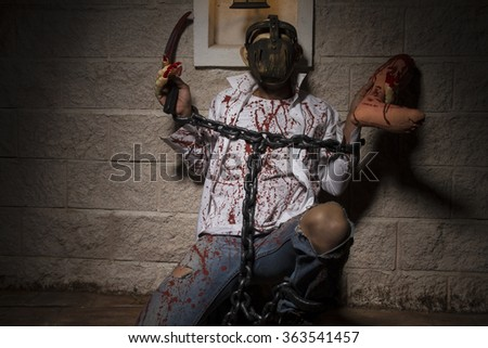 halloween monster chained with bloody hook, night scene and terror