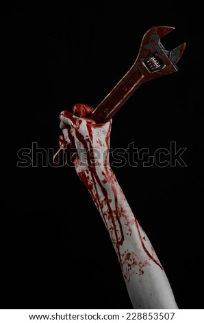 Halloween theme: bloody hand holding a big wrench