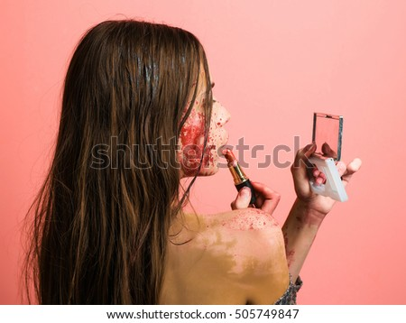 Young girl mask on her face stock photo 573131455 for Mirror zombie girl