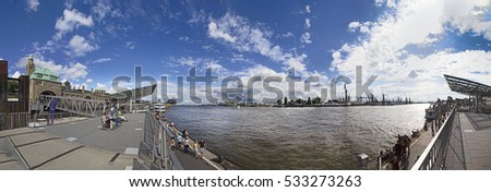 HAMBURG, GERMANY - JULY 30, 2016: people enjoy the view from the Landungsbruecken in Hamburg to the harbor.