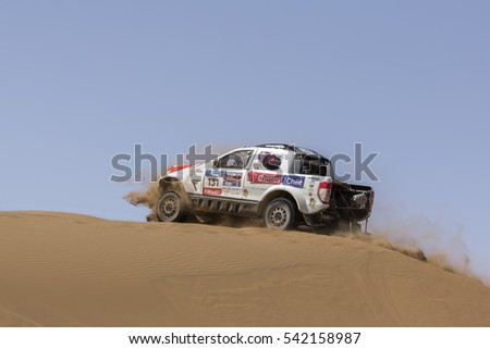 HAMI, CHINA-JULY 18, 2016: Sports car gets over the difficult part of the route during the Silk Way rally Moscow-Beijing Dakar series in the sand desert