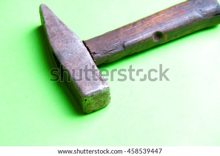 hammer on a green background
