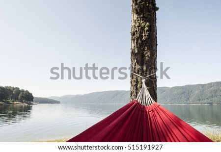 Hammock on the shore of a mountain lake