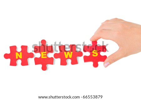 Hand and puzzle News isolated on white background