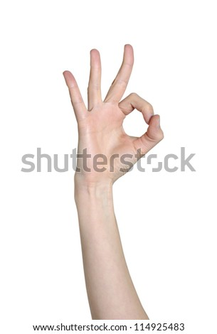 Hand close-up shows a gesture ok is isolated on a white background