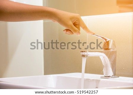hand close water tap. Selective focus