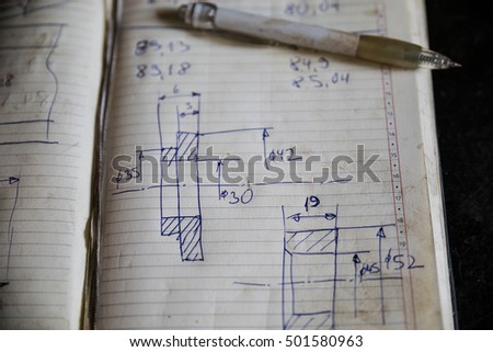 Hand drawn sketch of machine part on white paper