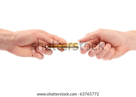 hand gives credit card to another hand