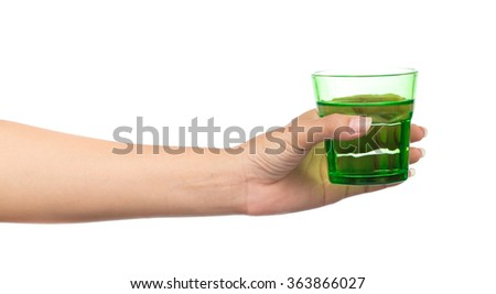 hand holding a green glass of pure water isolated on white background