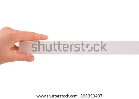 Hand holding a piece of paper on a white background
