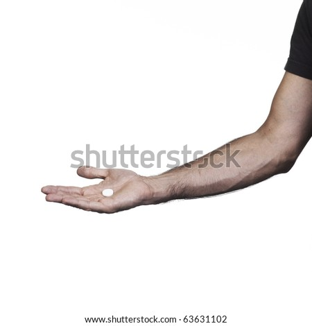 Hand holding a white tablet on a white set