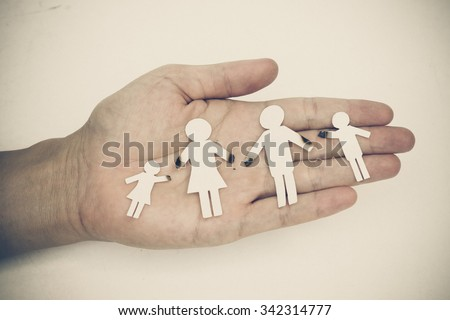 hand holding broken paper cut family