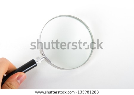 Hand holding classic style magnifying glass, isolated on white background.