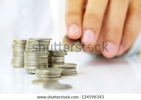 Hand holding coin stack, investment concept