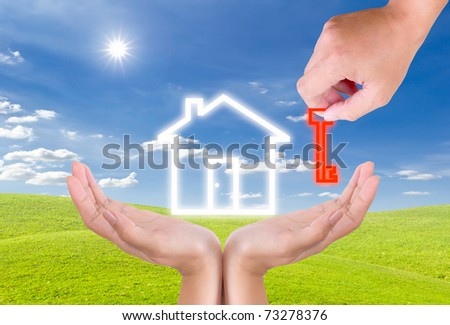 hand holding key for house icon