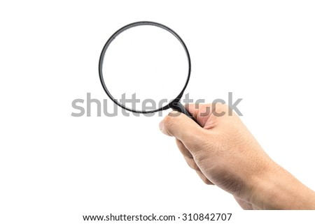 Hand holding magnifying glass on white background.