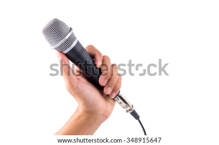 hand holding microphone isolate on white with clipping path