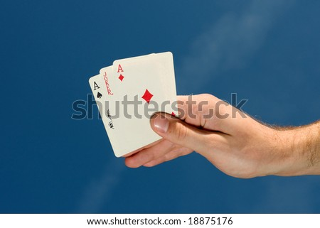 Hand holding playing cards