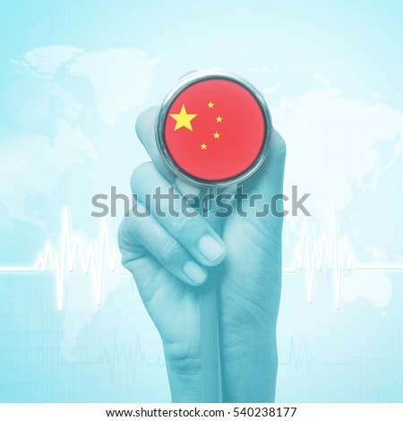hand holding stethoscope with China flag.