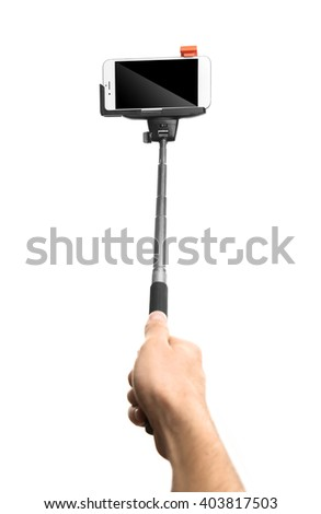 Hand holding stick for making photo with mobile phone, isolated on white