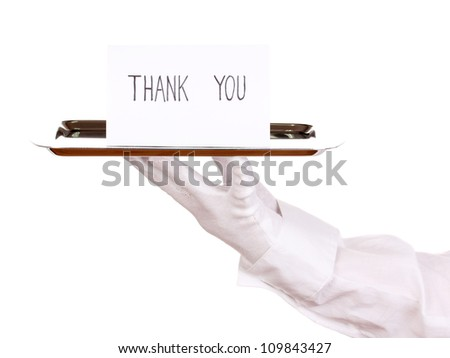 Hand in glove holding silver tray with card saying thank you isolated on white