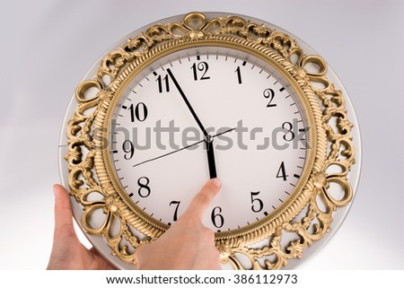 hand  in touch with a clock on a white background