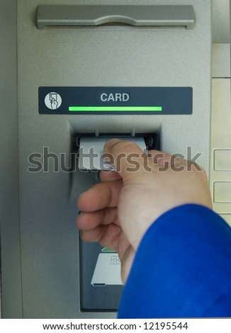 hand inserting blank card into cash machine