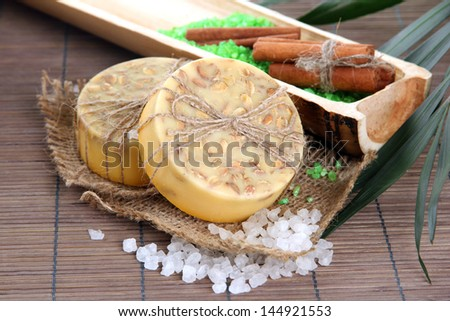 Hand-made soap and sea salt  on grey bamboo mat