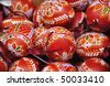 Hand-made traditional red Easter eggs - stock photo