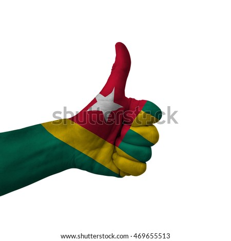 Hand making thumbs up sign, togo painted with flag as symbol of thumbs up, like, okay, positive  - isolated on white background