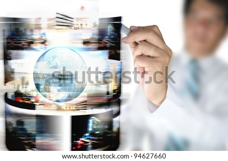Hand of business man draw streaming images with earth globe