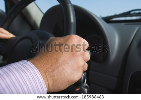 hand of businessman driving