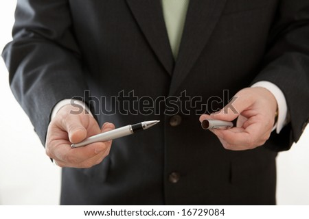 Hand of businessman holding pen to sign contract
