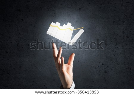 Hand of businessman showing business growth concept