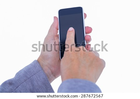 Hand of woman touching smartphone on white background