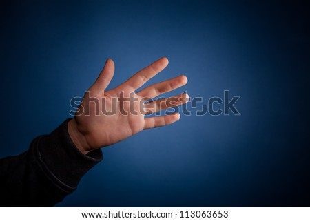 hand on blue  background