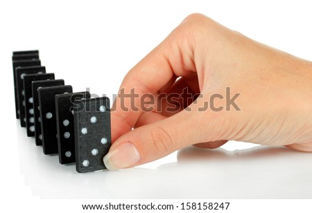 Hand playing domino isolated on white